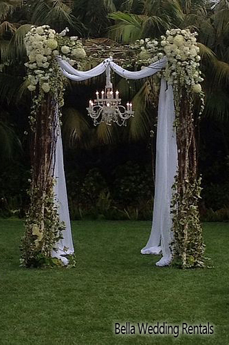 Twig, fabric and floral wedding altar.