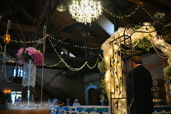 Wrought Iron Wedding Arch with Wine Barrels