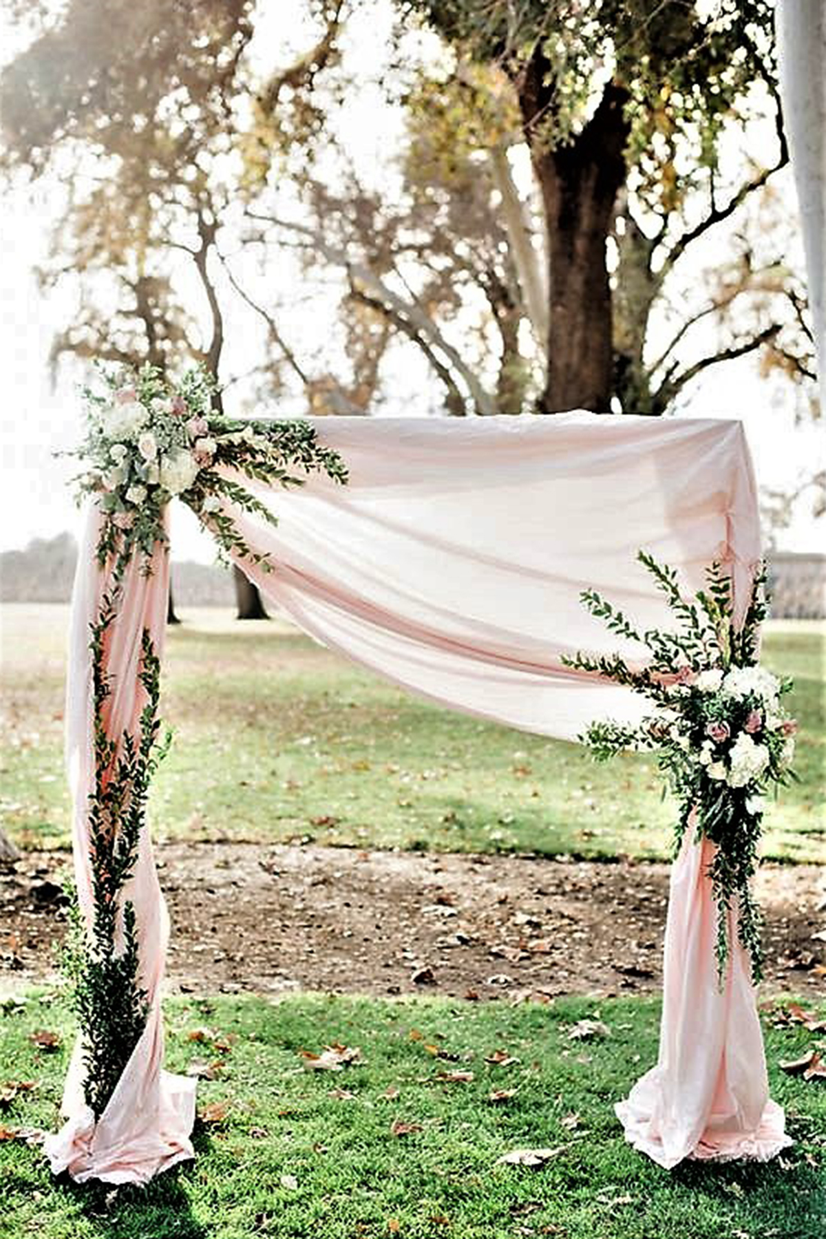 arch draped with faux flowers