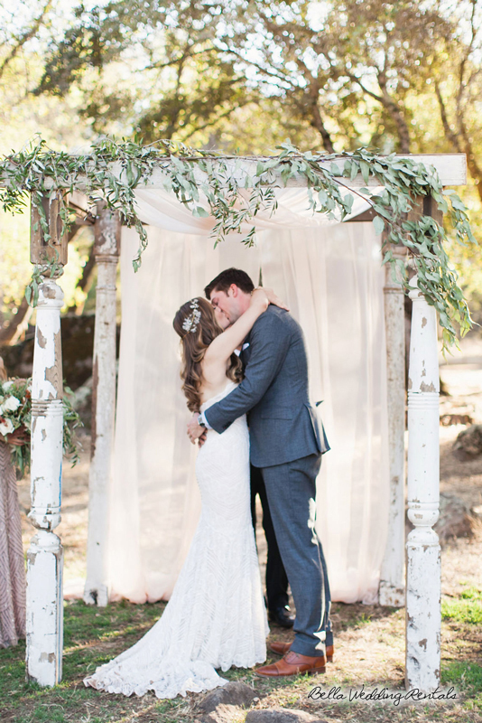Wood column arch withfabric - wedding arch