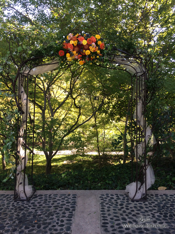 wrought iron and fabric wedding arch