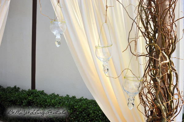 Twig Arch w hanging globe that hold votives
