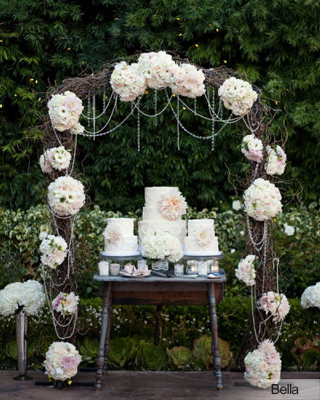 twig, floral and jeweled wedding arch