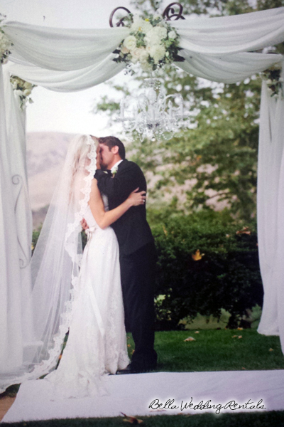 fabric and flower wedding arch