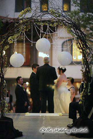 twig and jeweled wedding arch