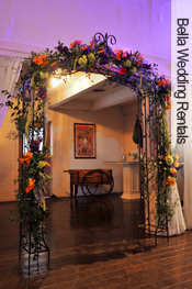 rust wrought iron decorated wedding arch